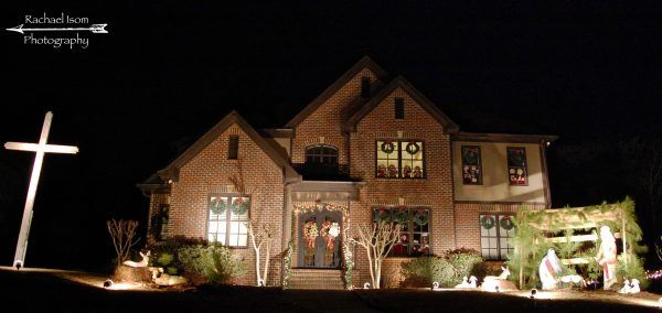 241 Stoneykirk Way, Two story brick house, at night, with a cross on the left side of the yard